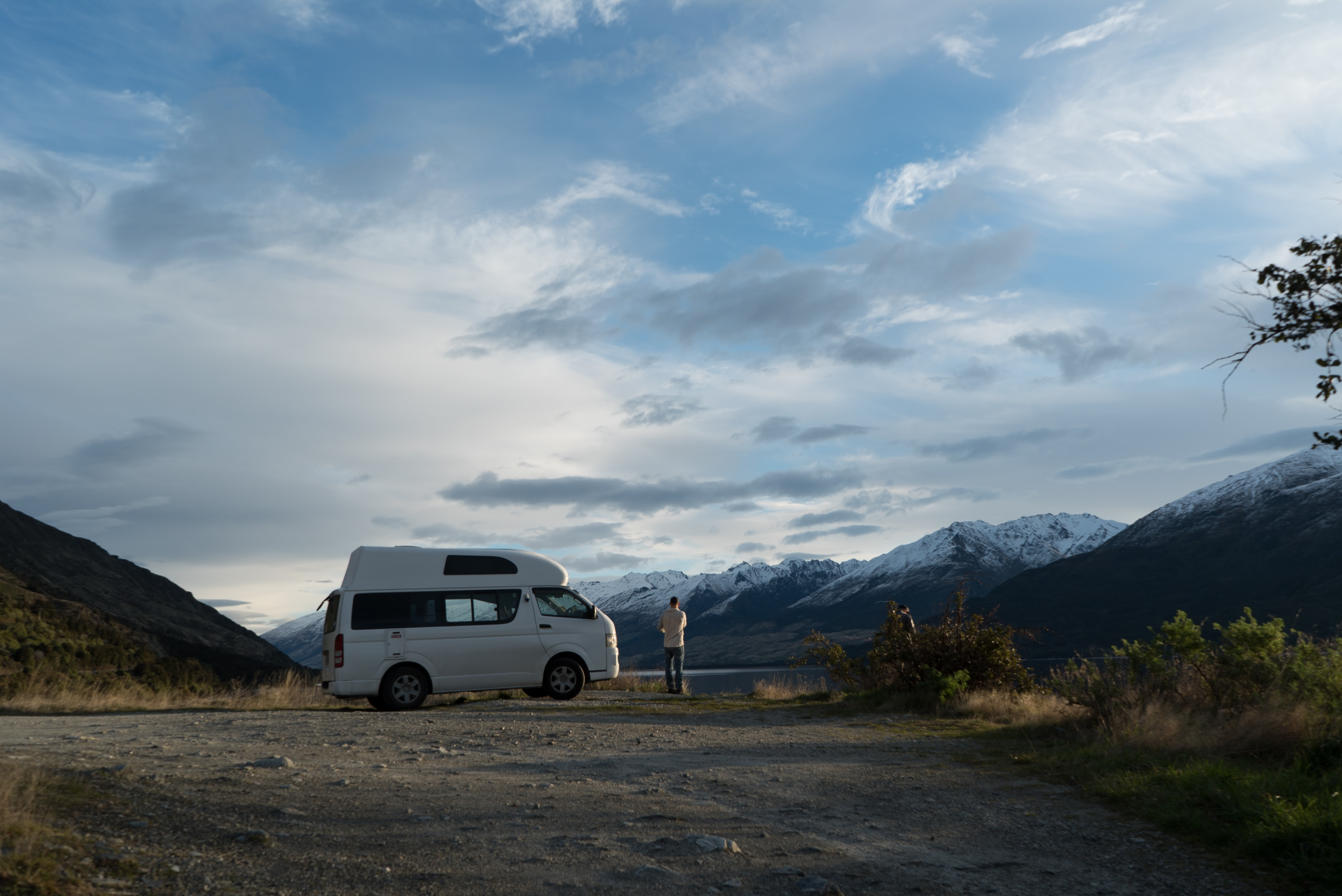 person standing in front of a white van