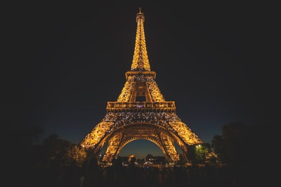 eiffel tower during nighttime paris teams background