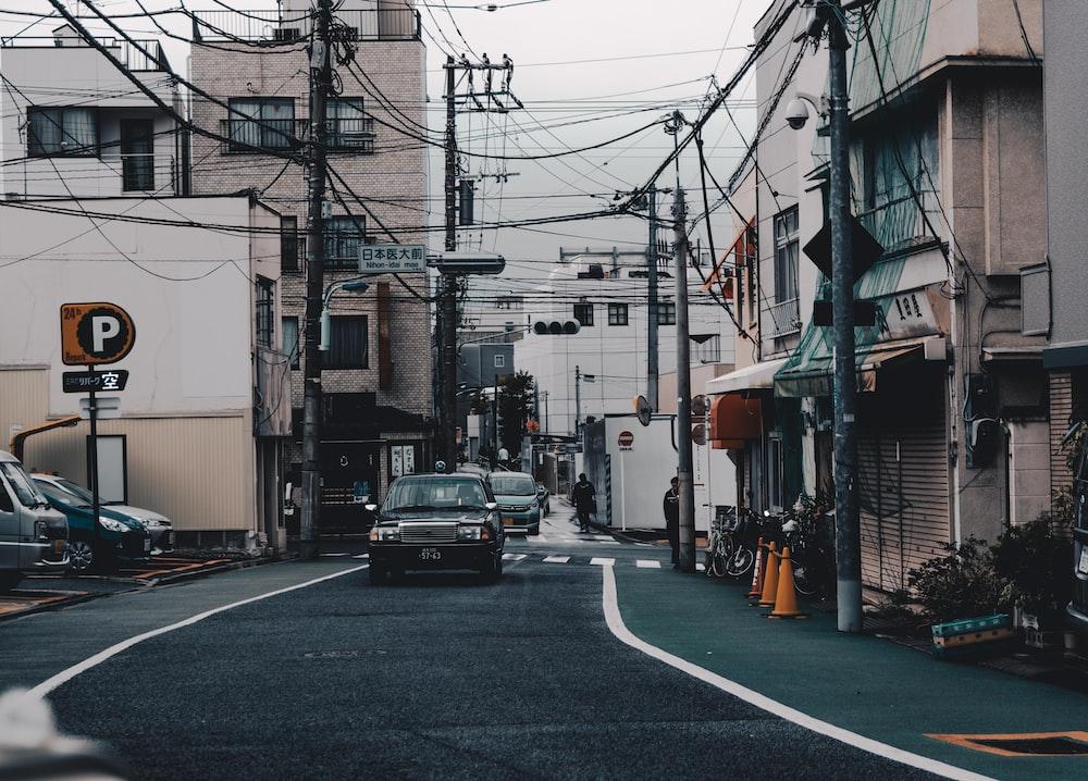 black vehicle on asphalt road