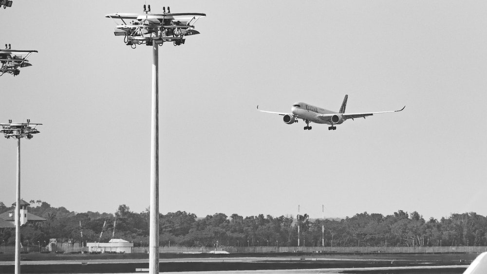 grayscale photography of airplane