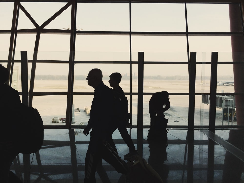 silhouette of people in the airport