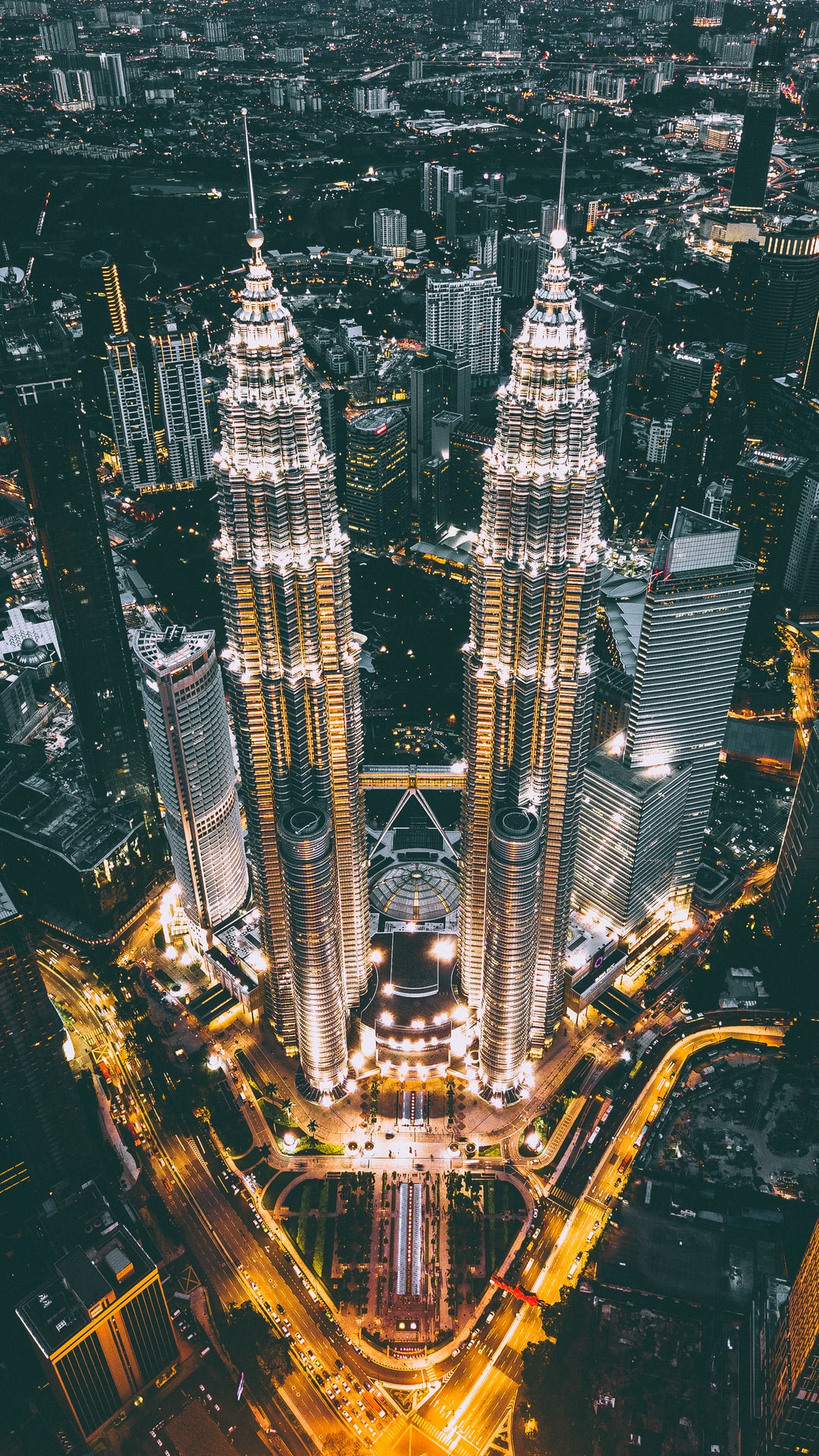 We were looking for some nice photos of KLCC Tower during sunset, but unfortunately there are a lot of clouds on that day. So we're doing a quick portrait shot of KLCC from DJI Mavic. It's on around 7:00PM.