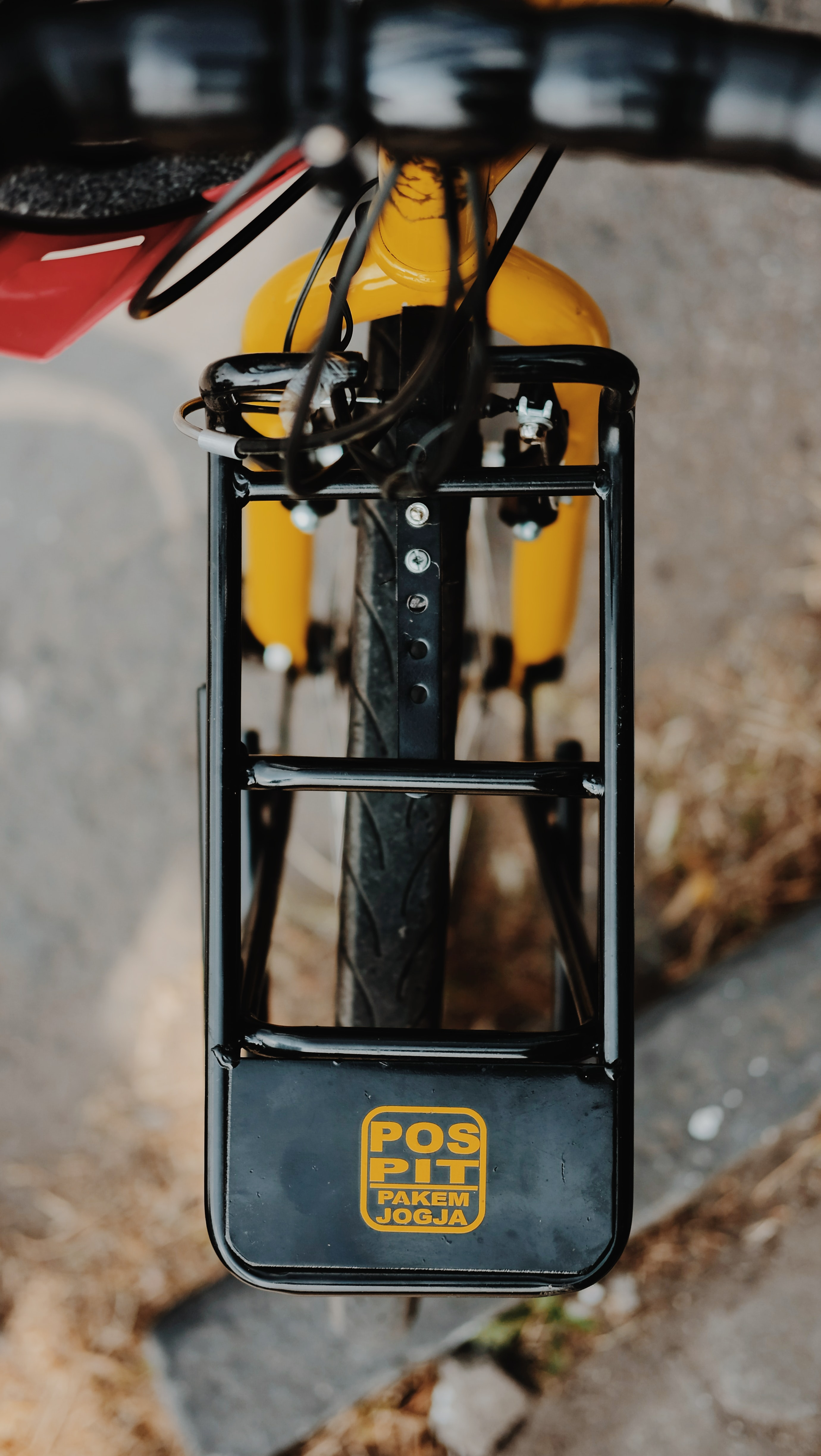 yellow and black Pos Pit bicycle part