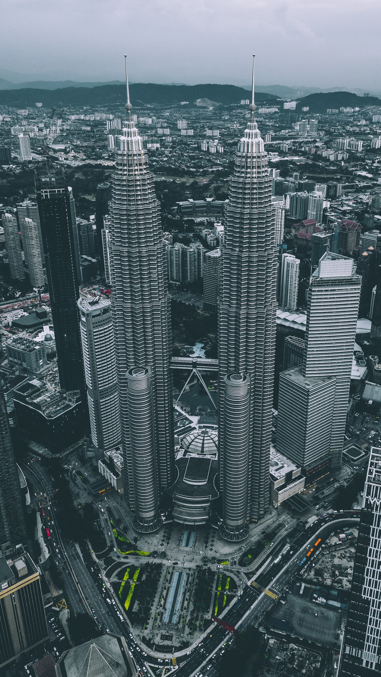 aerial view of gray twin tower concrete buildings under gray sky