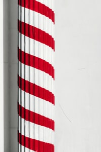 red and white painted pedestal column
