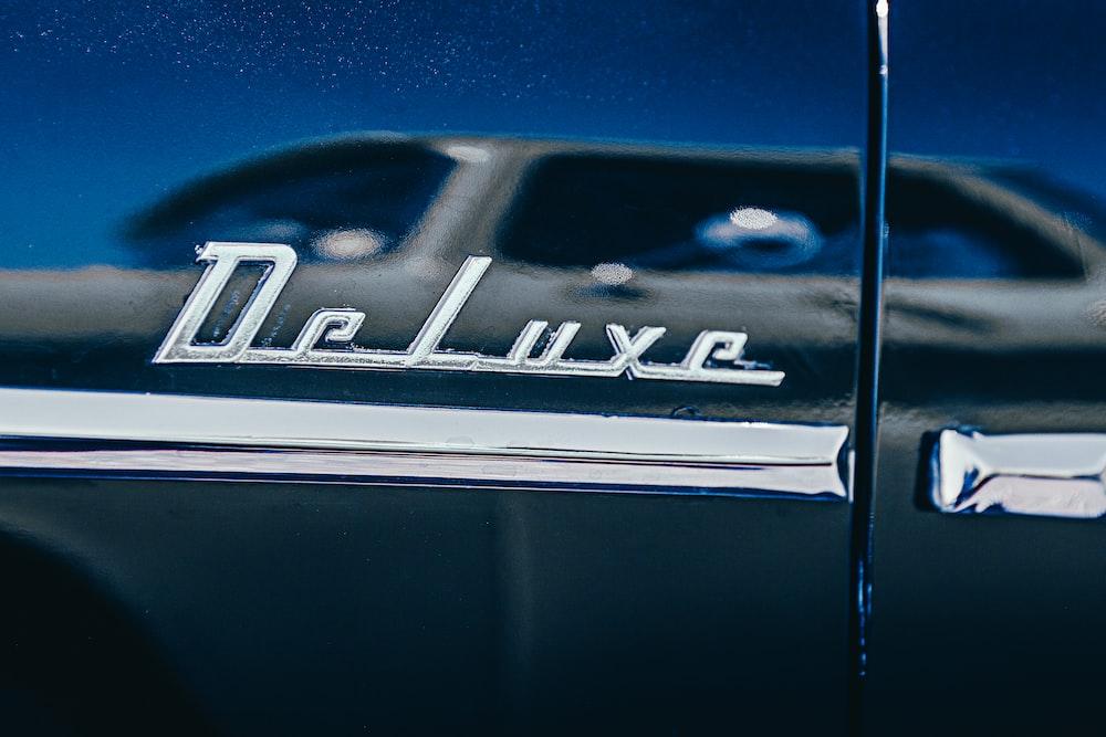 Selective Focus Photography Of Chromed Deluxe Car Emblem Photo Free Emblem Image On Unsplash