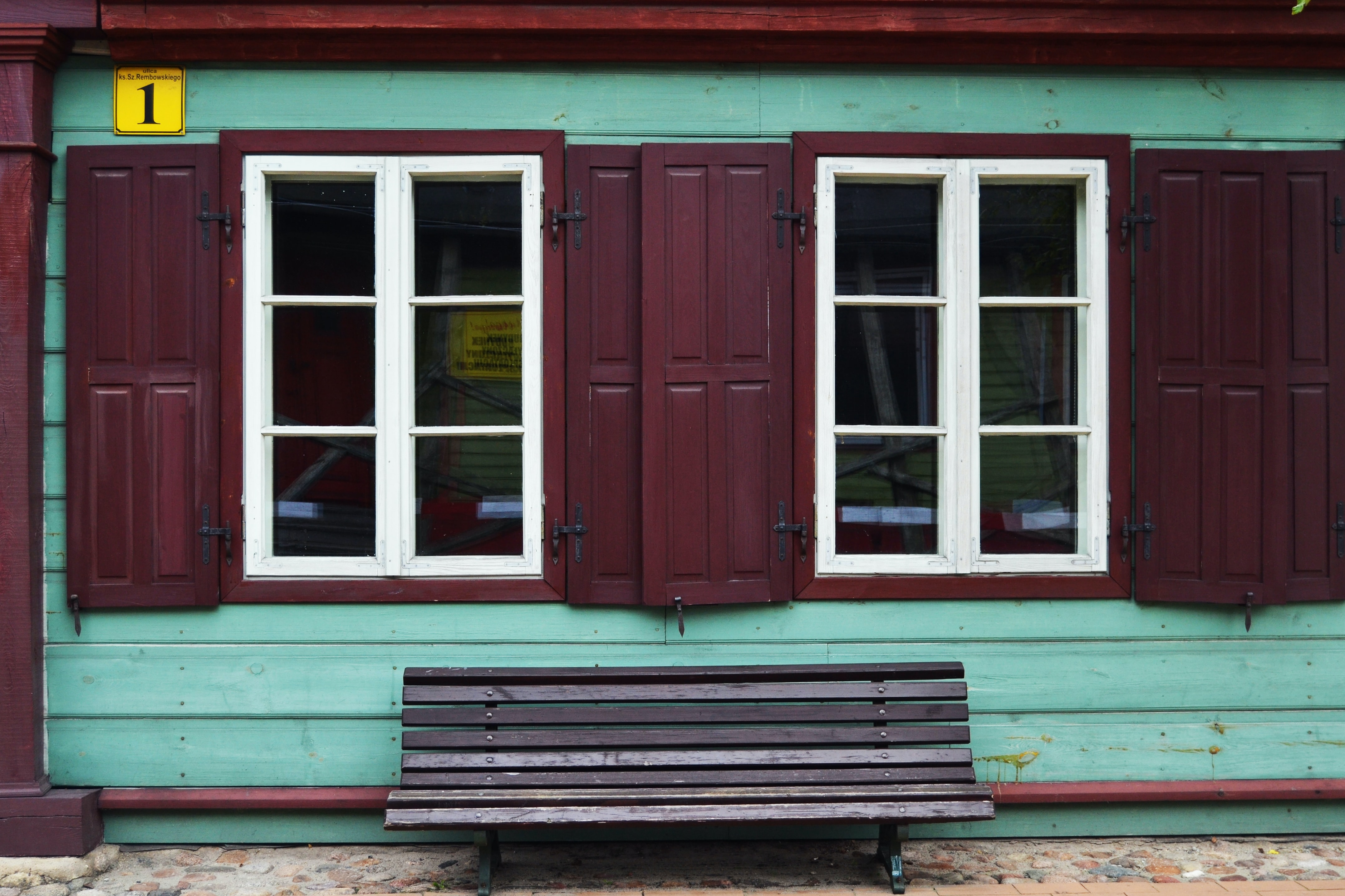 teal house with two windows