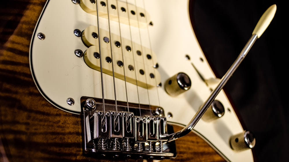 close up photography of brown electric guitar