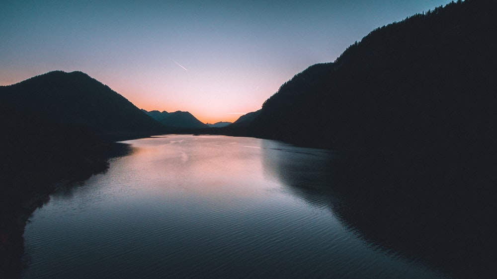 body of water between mountains