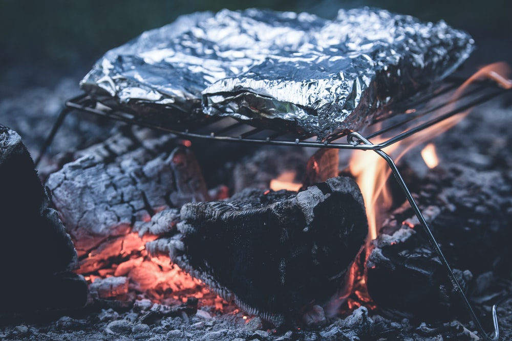 food on foil grilled on charcoal