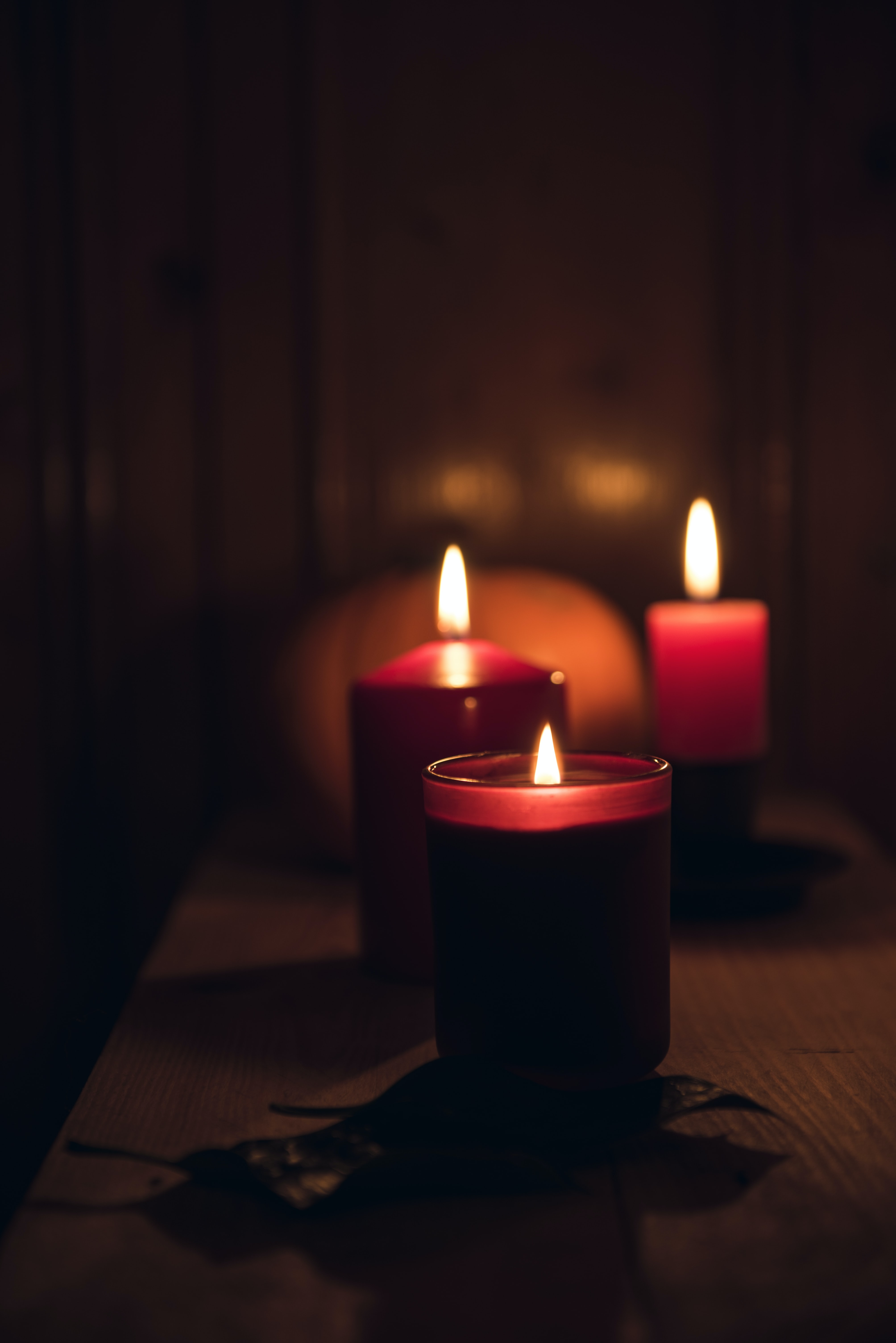 candles with fire during nighttime