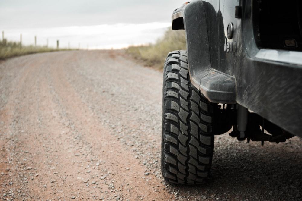 black Jeep SUV on rocky road