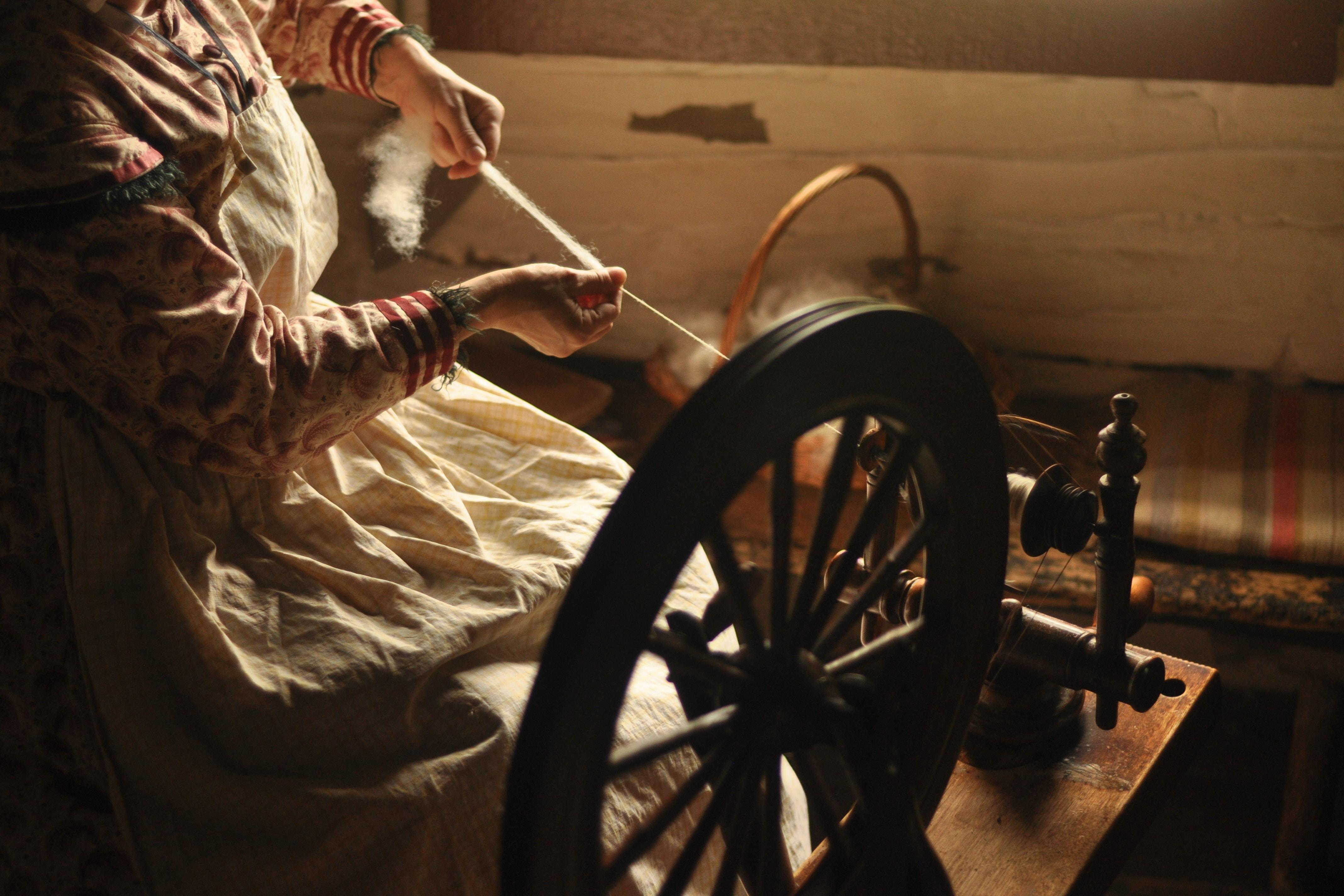 woman using spinning wheel
