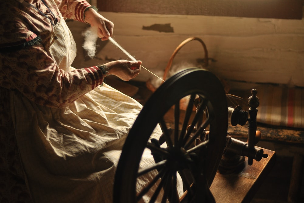 woman using spinning wheel