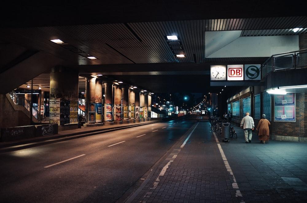 two person walking on side street