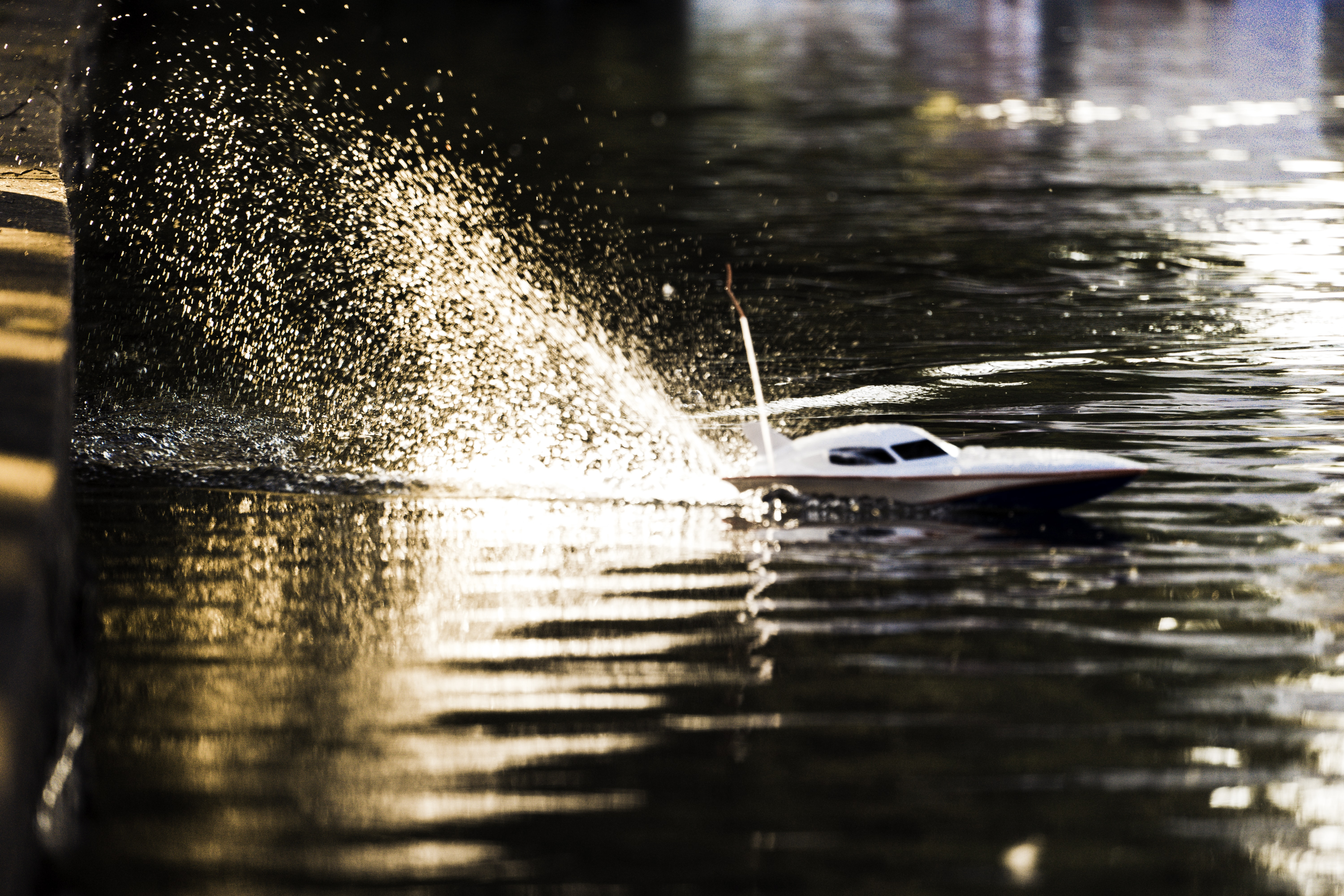macro shot photography of white remote controlled boat toy
