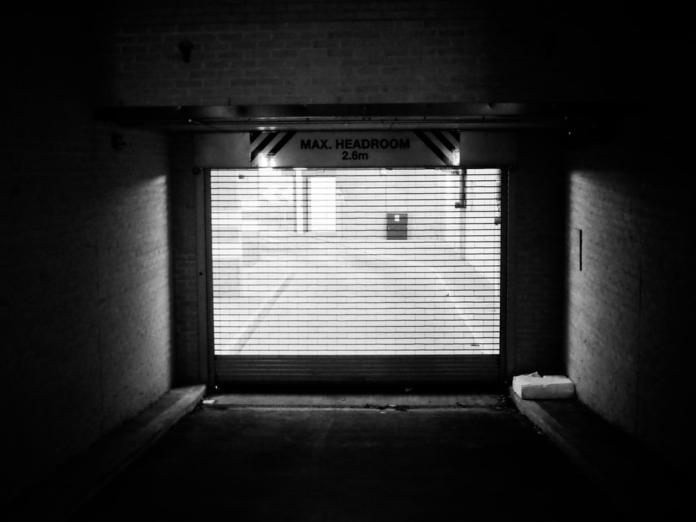grayscale photo of garage door