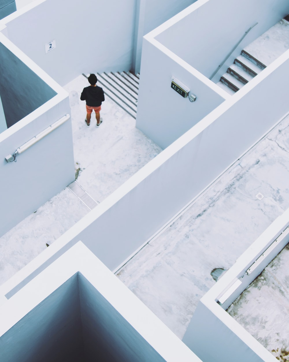 man in maze-like building