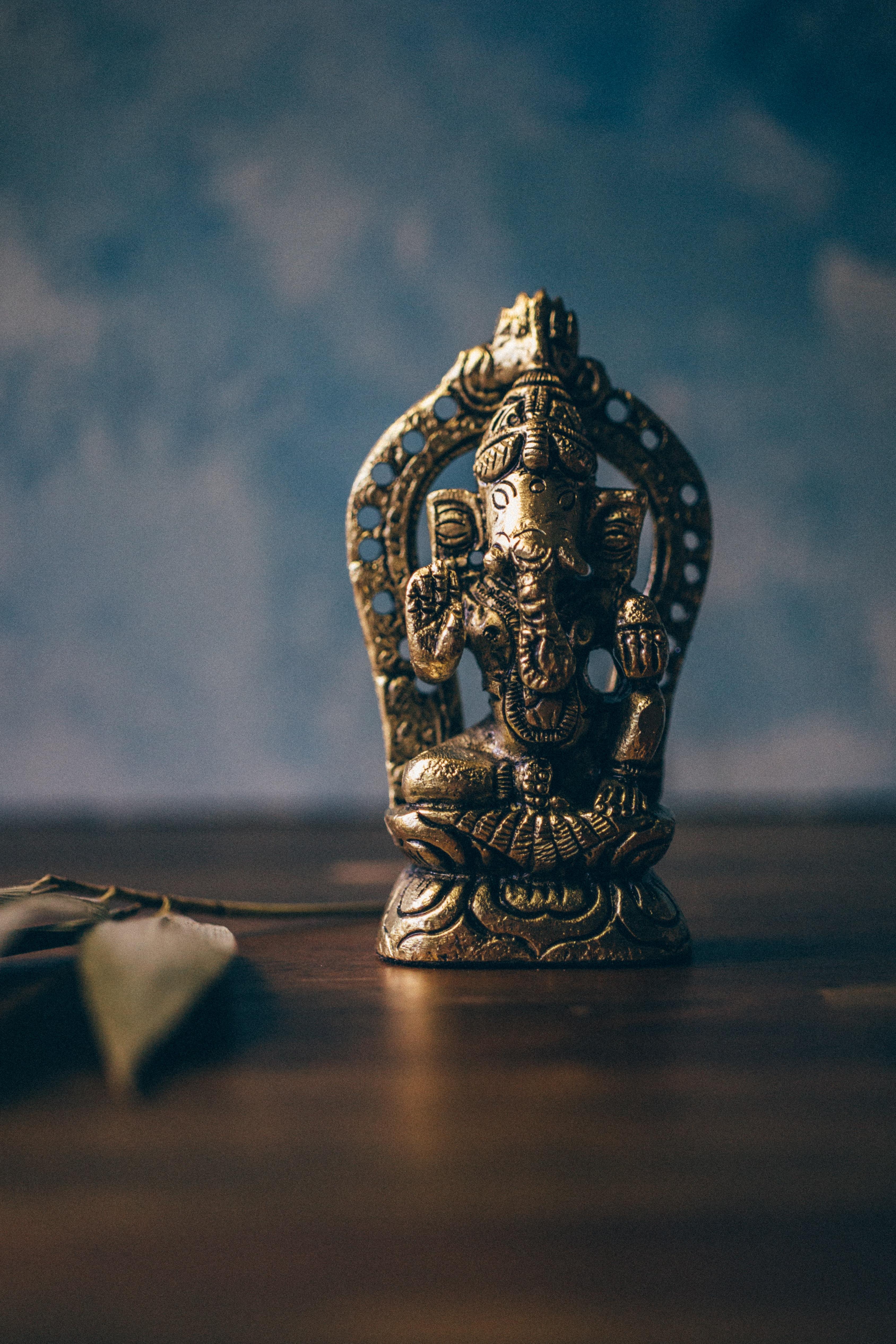Ganesha figurine on brown surface