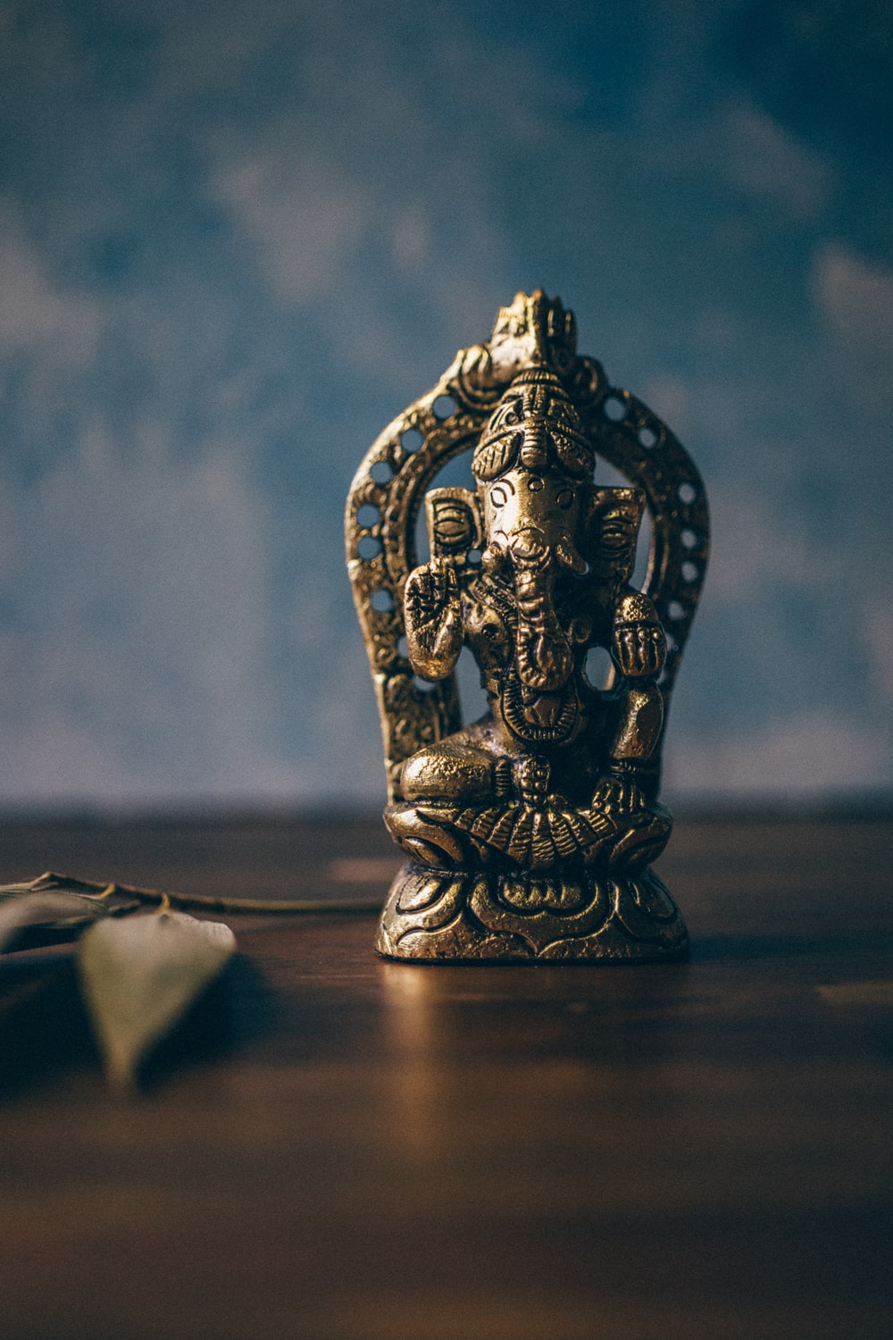 Ganesha figurine on brown surface