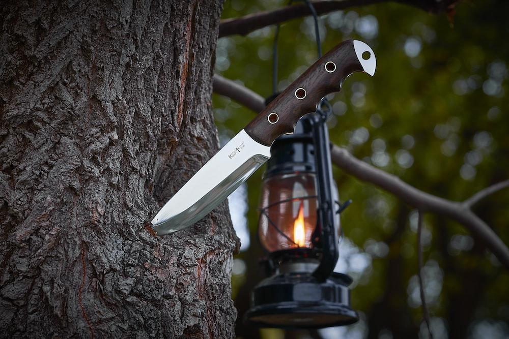 combat knife on tree trunk