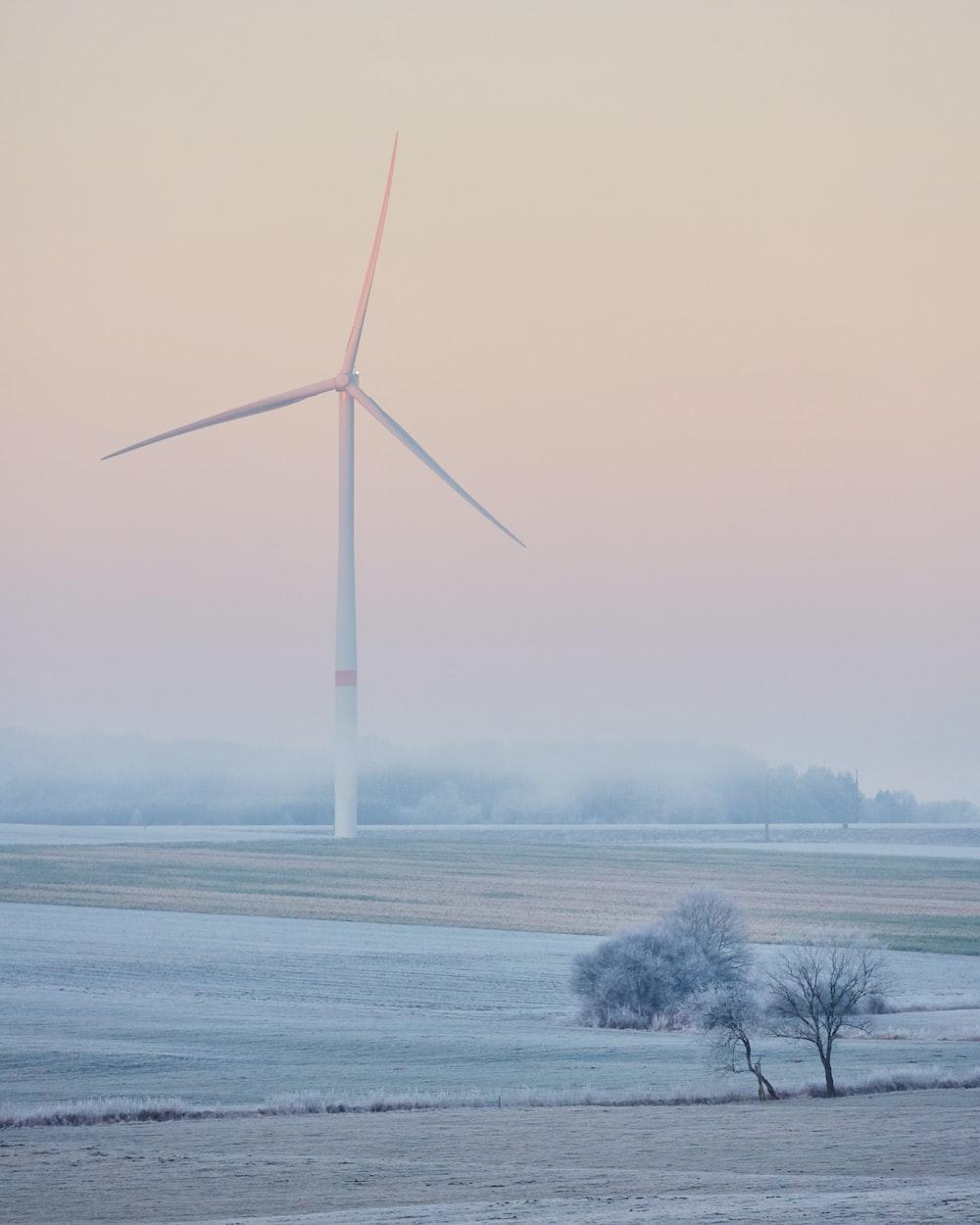 landscape photo of windmill on grass field