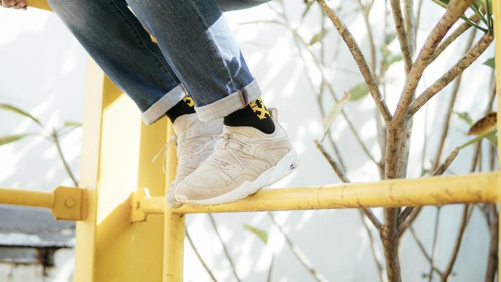person wearing beige Puma Trinomic sneakers photo – Free Shoe ...