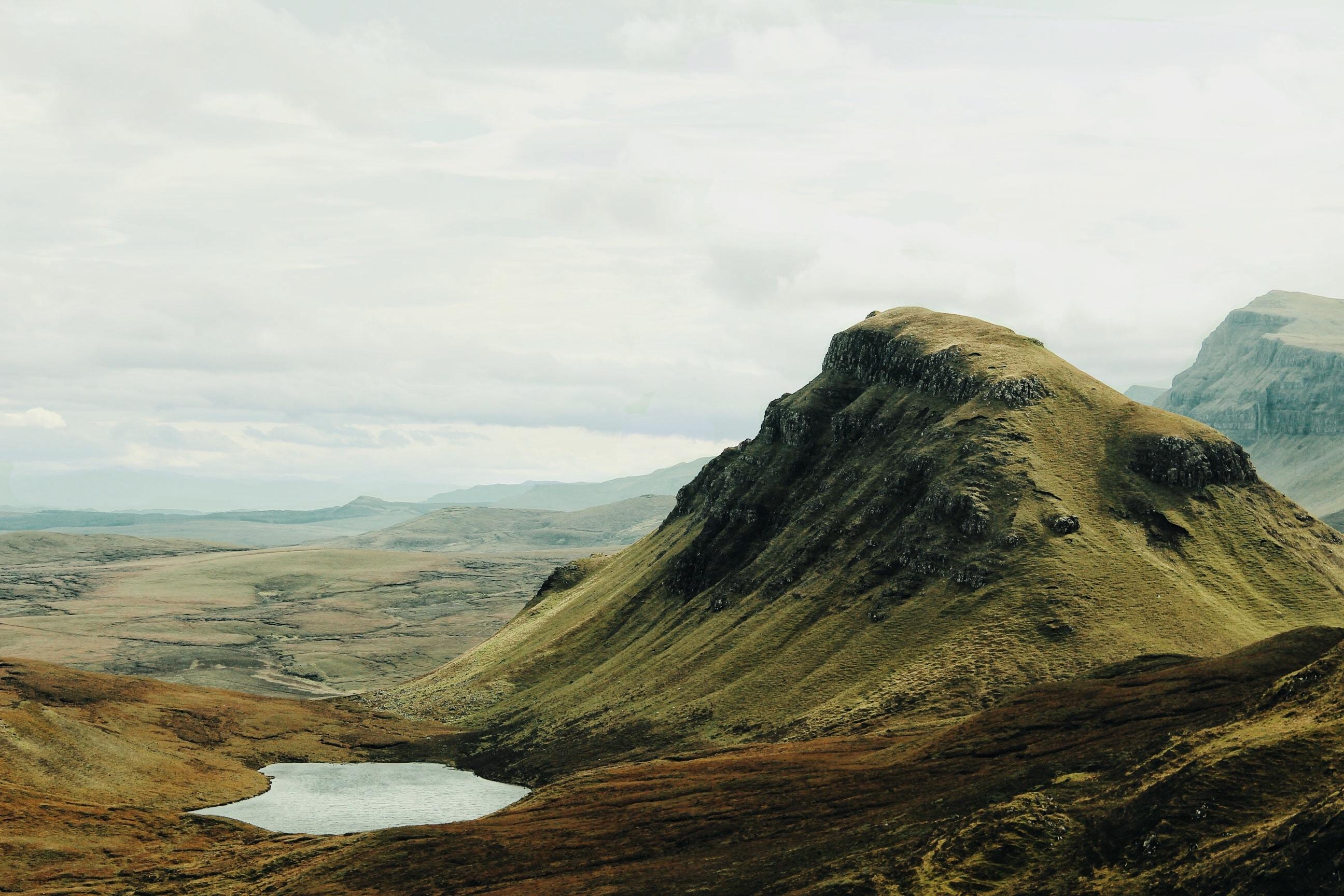 mountains next to lake