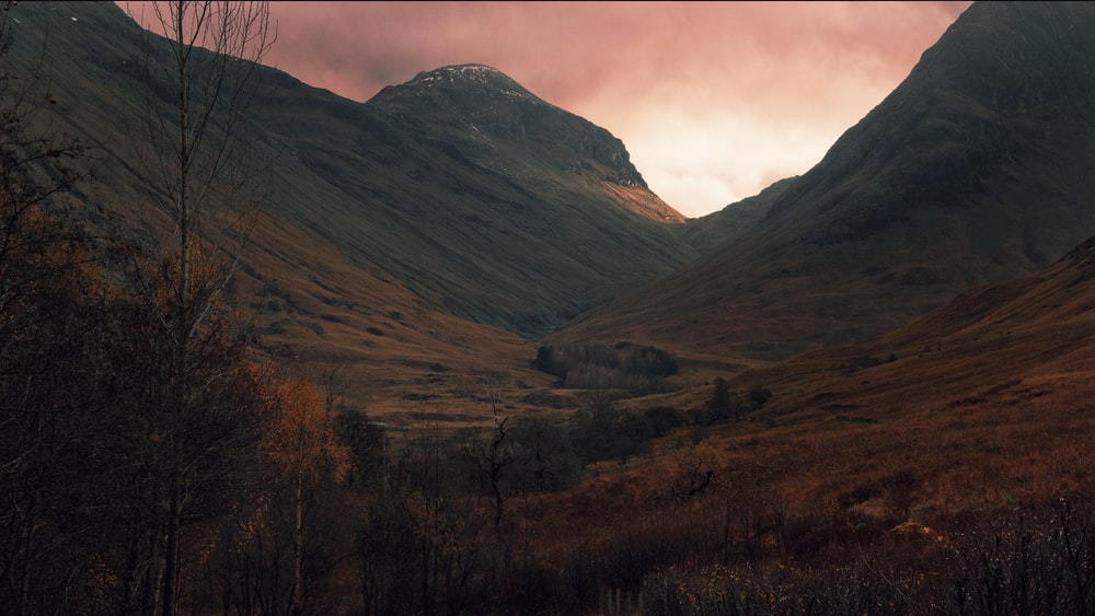 brown mountain under sunset