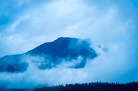 mountain covered with white clouds