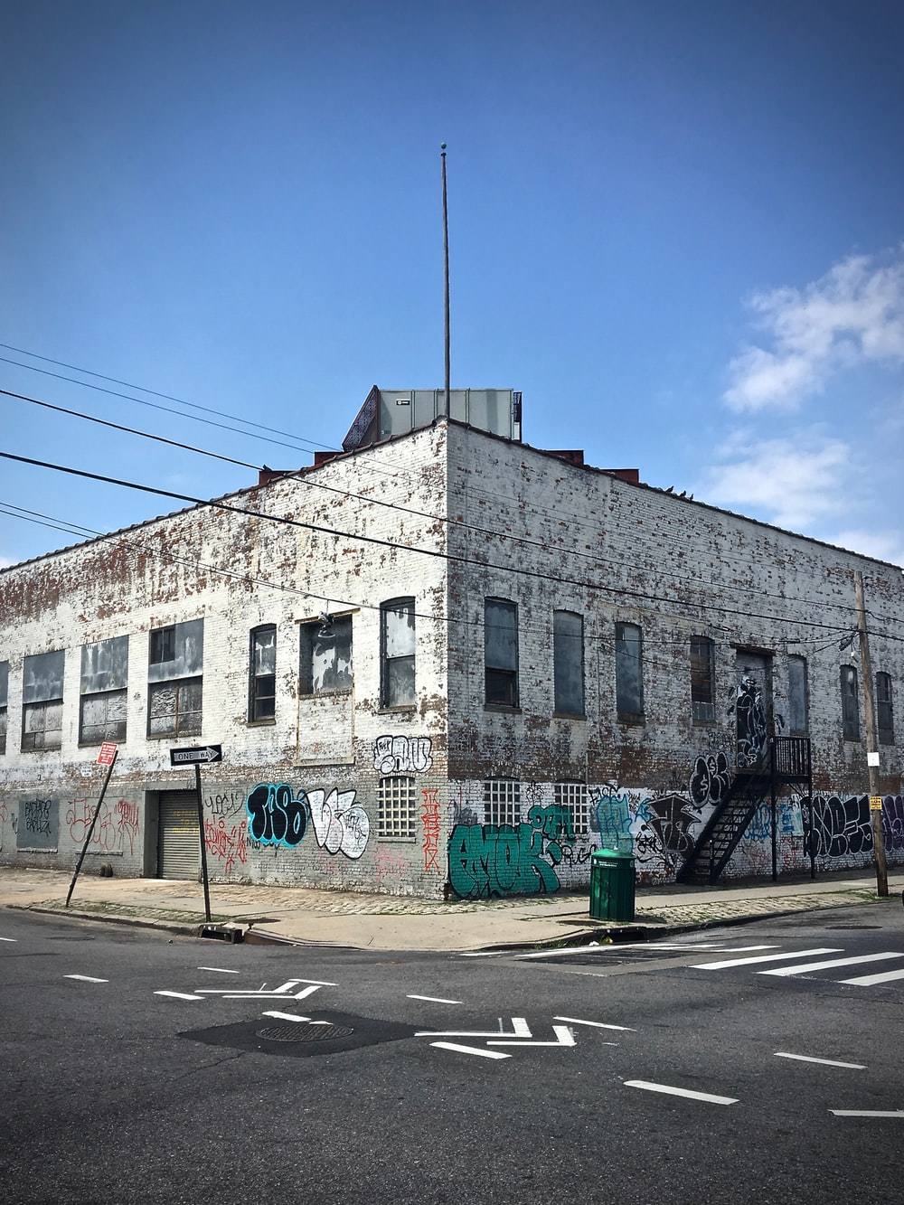 corner photo of gray concrete mid-rise building