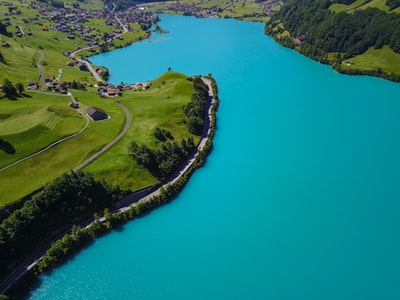 aerial photography of village near body of water switzerland teams background