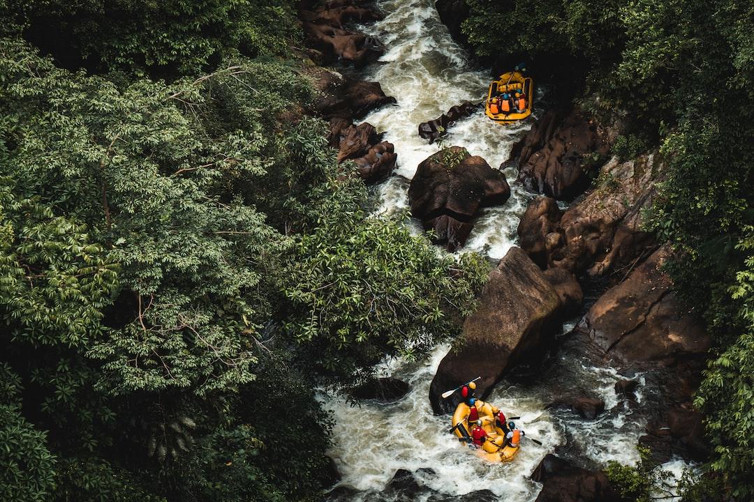 Two teams enjoying white water rafting activities
