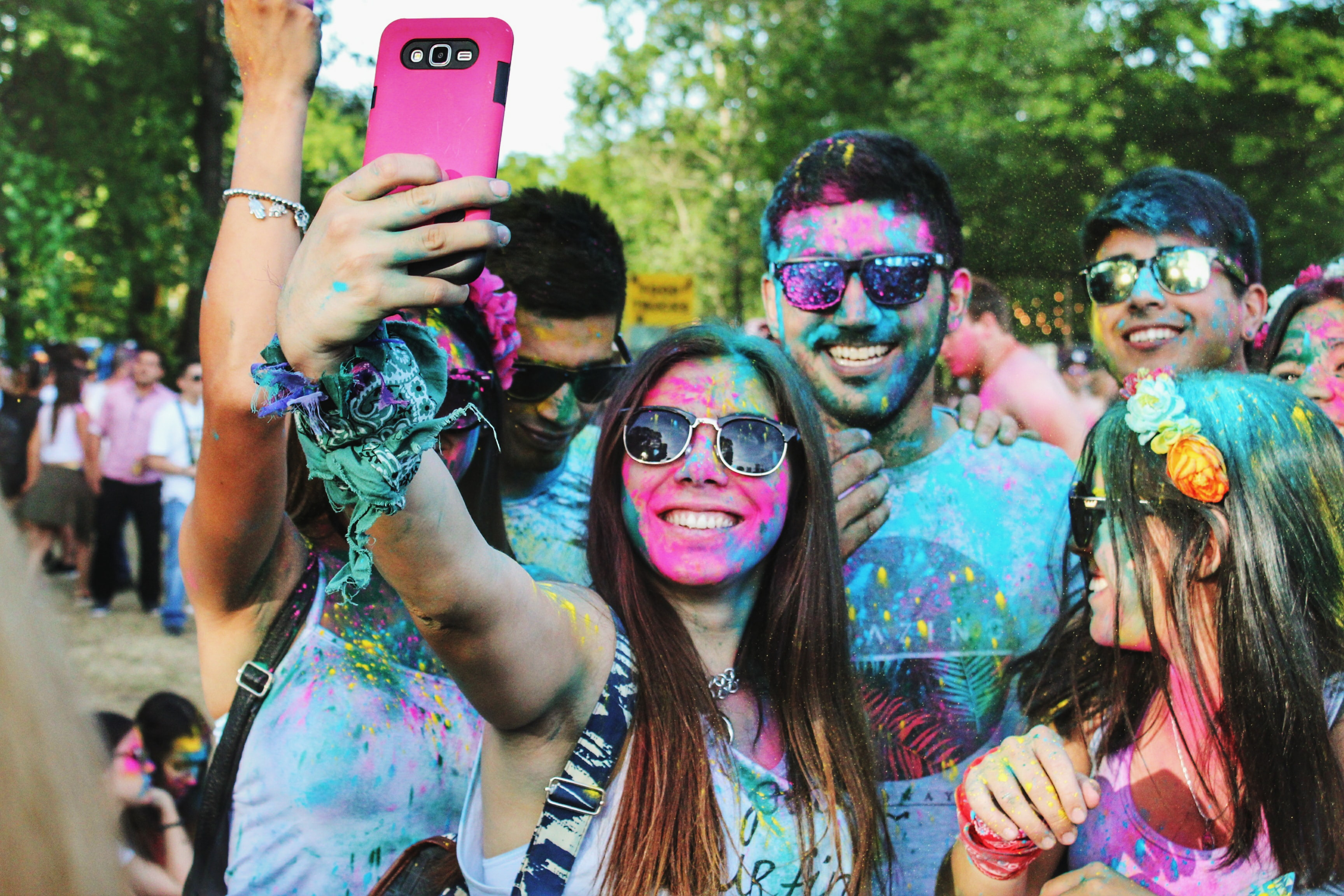 group of people taking groufie with face paints on their face