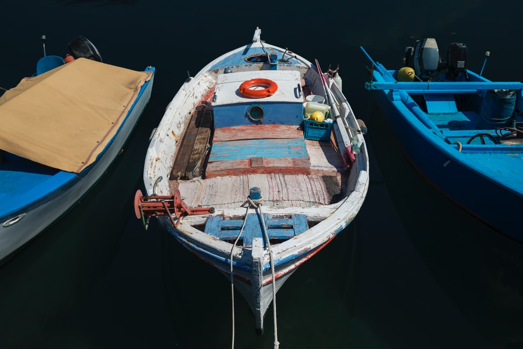 A small Port in Nea Artaki, Euboea - Greece, hosts many Old-Fashioned Small Fishing Boats, ready to embark on their Fishing Trip or even take some Tourists on a local Exhibition