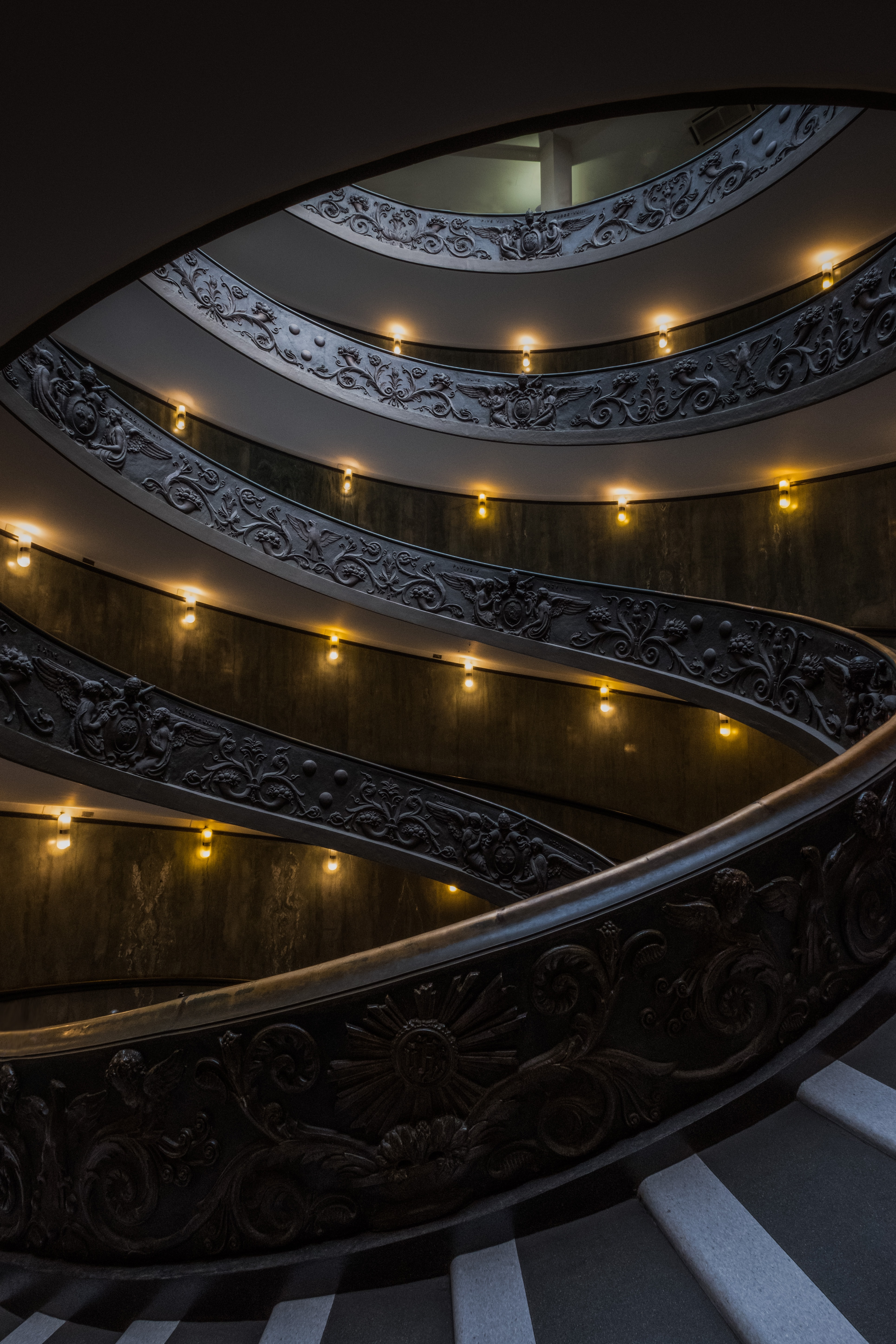 gray concrete stairway with lights