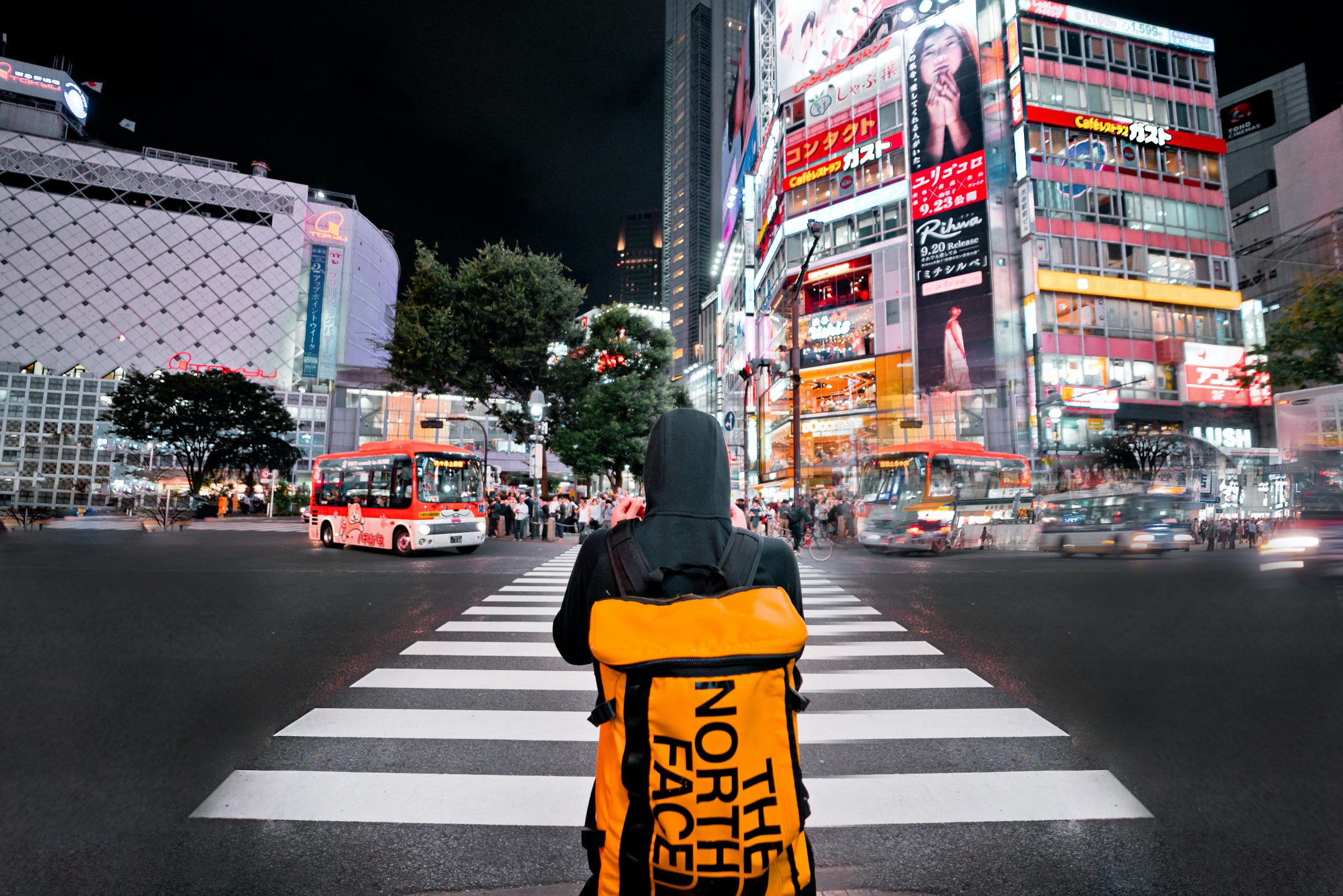 person wearing backpack standing in front of New York Time Square