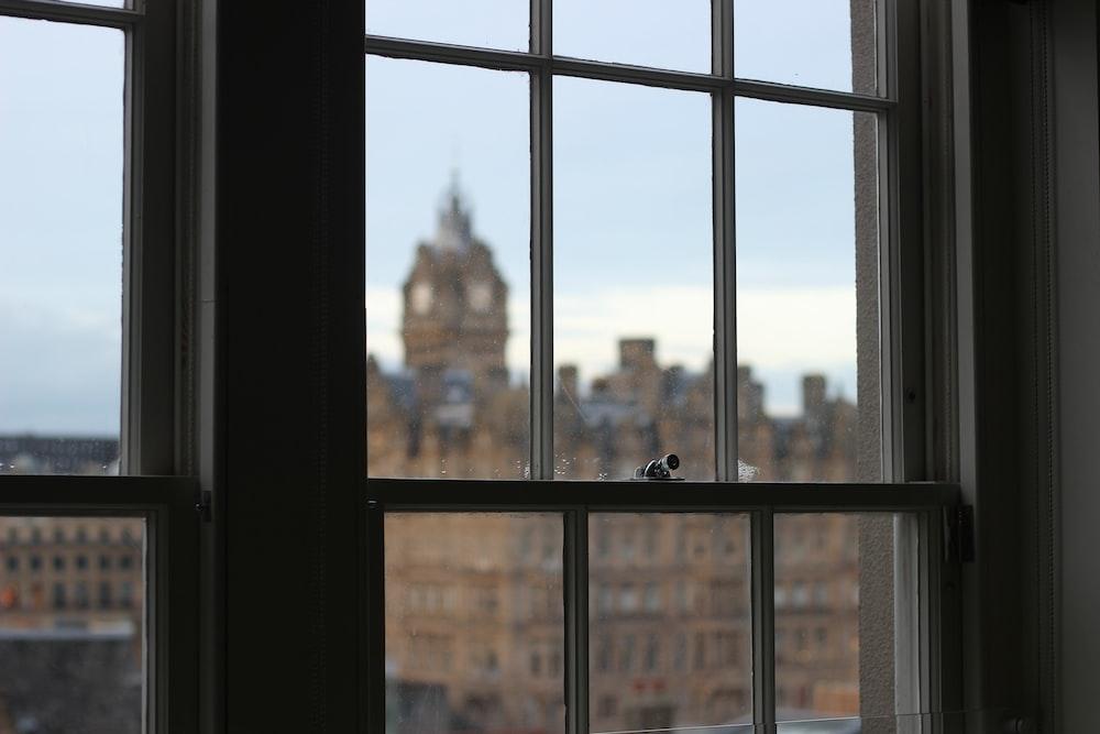 glass window pane facing Big Ben