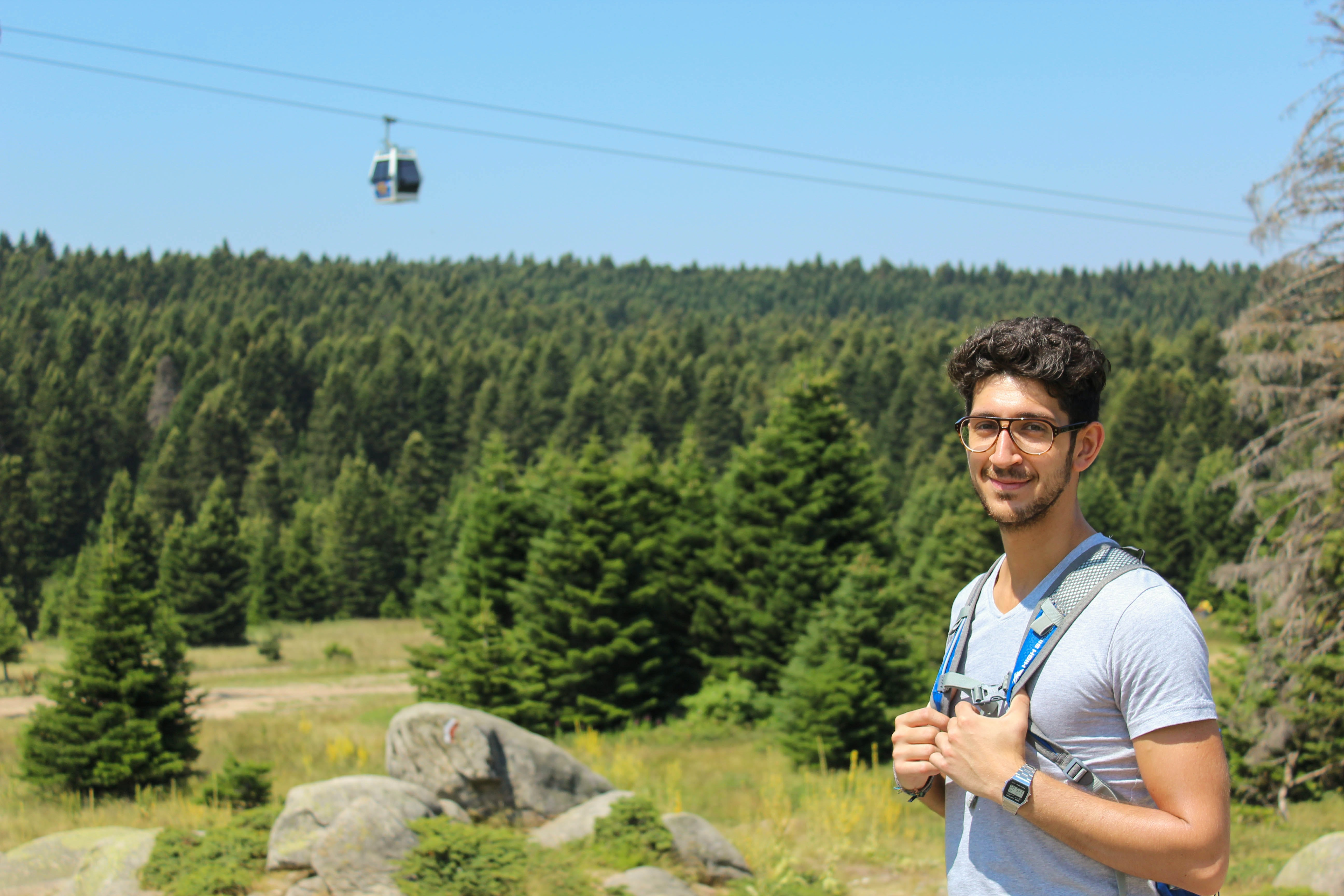 man standing near cable car during daytime