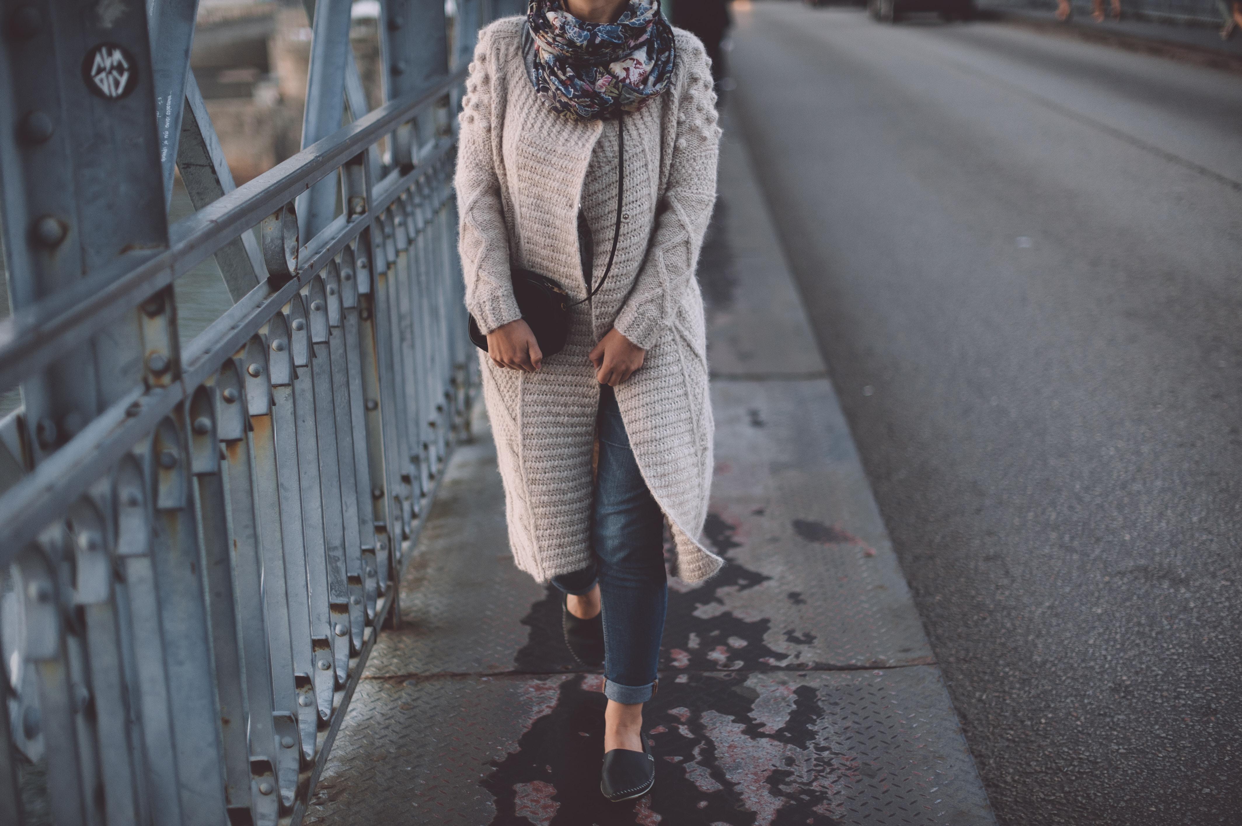 woman walking at the bridge