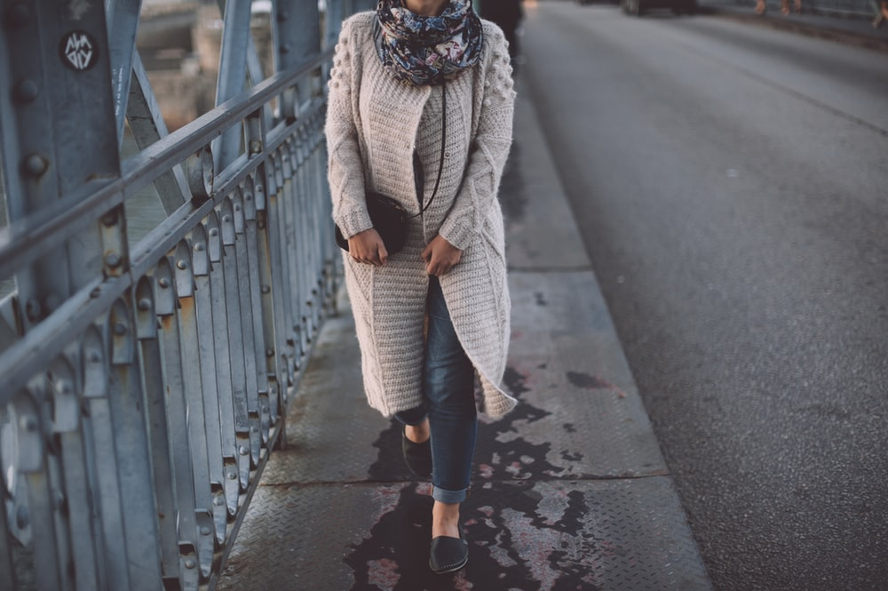 woman walking at the bridge