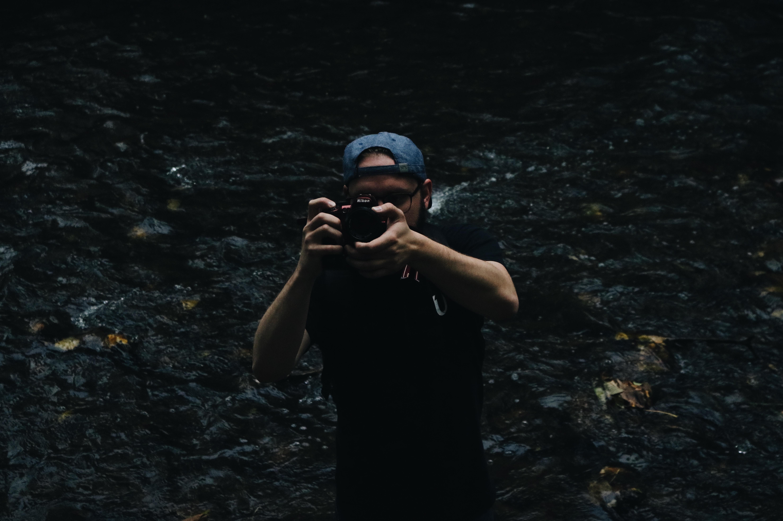 man taking a photo using a DSLR camera