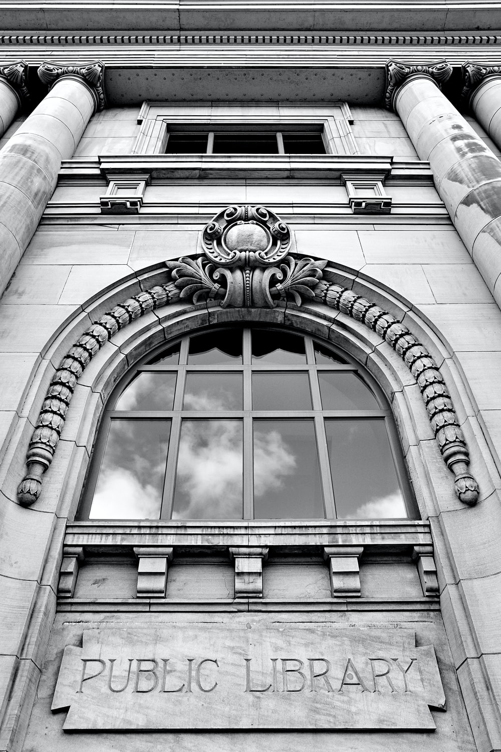low-angle photography of Public Library arch window