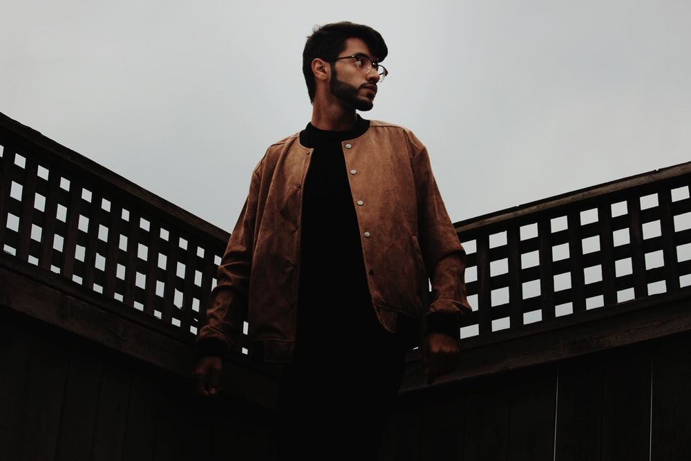 man standing on black fence
