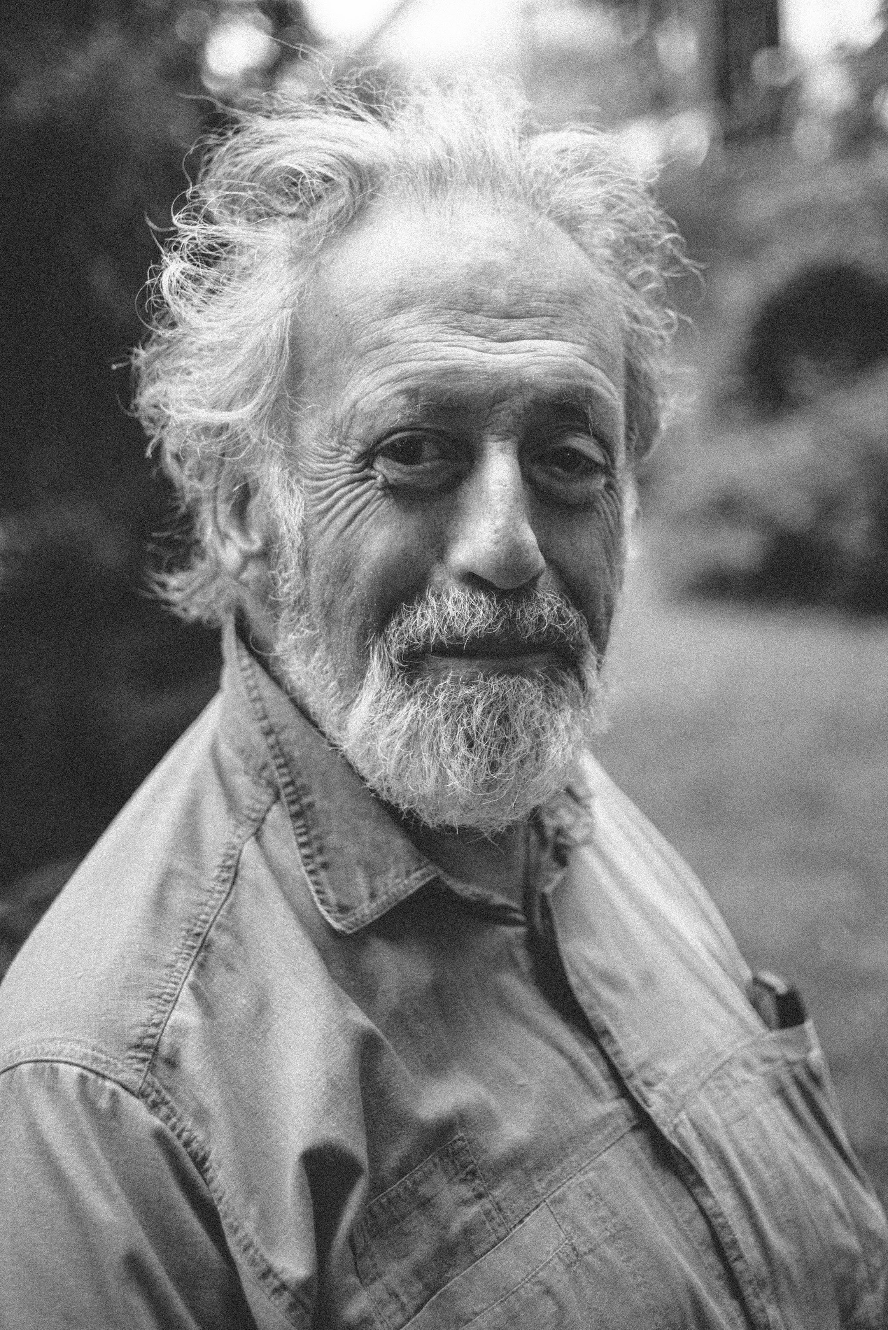 grayscale photograph of man's portrait