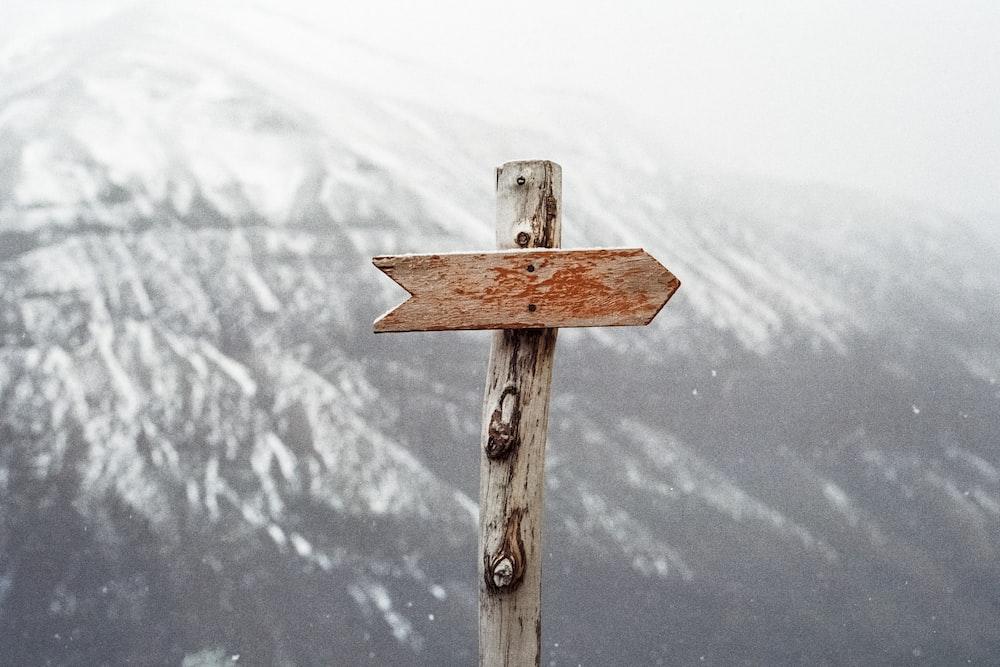 arrow sign on mountain