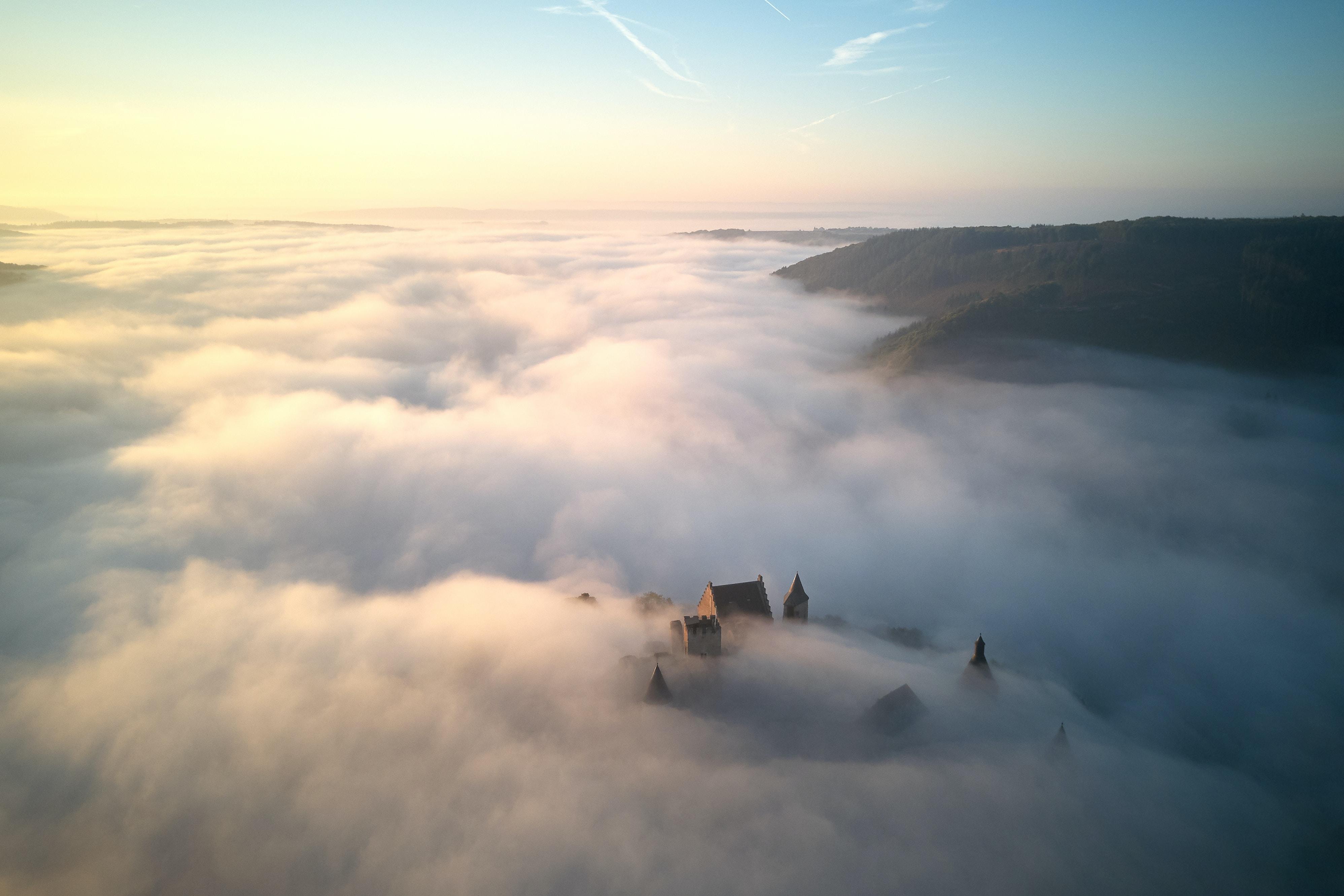 foggy castle near mountain