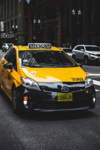 Toyota taxicab at the road in the city during day