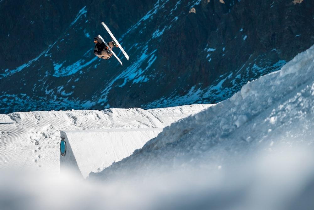 biplane flying near mountain