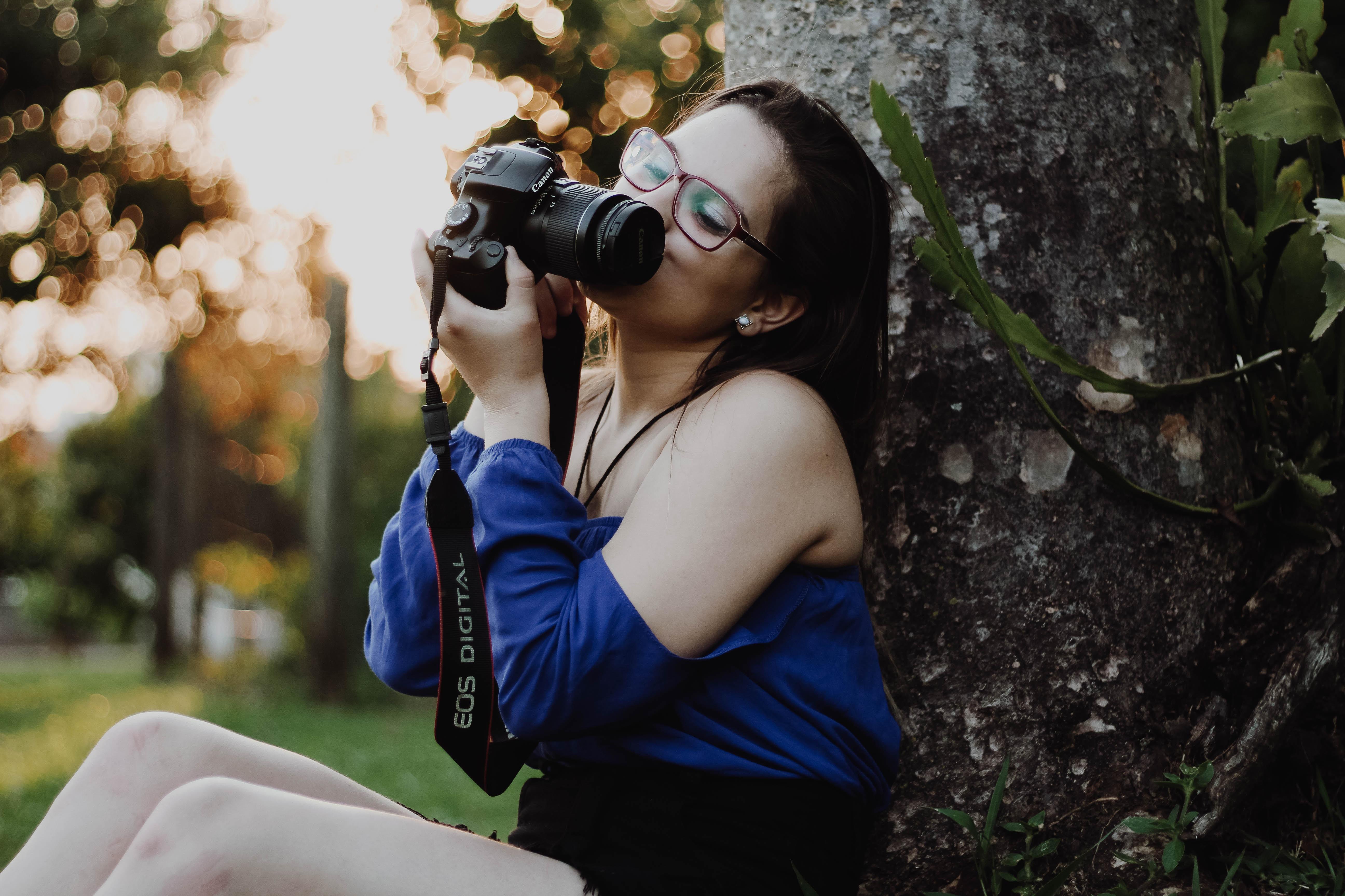 women's holding camera